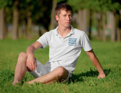 Polo Shirt Mockup Featuring a Young Man Posing at a Park m3003-r-el2