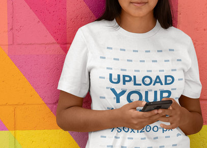 T-Shirt Mockup Featuring a Woman Leaning on a Colorful Wall 45102-r-el2