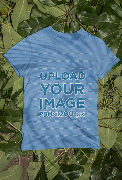 Mockup of a Tie-Dye T-Shirt Flat Laid over Green Leaves m4033
