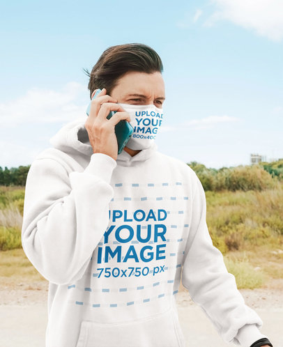Hoodie and Face Mask Mockup Featuring a Man on the Phone 45200-r-el2