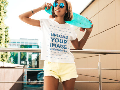T-Shirt Mockup of a Young Woman Holding a Penny Board Over her Shoulder M1511-r-el2