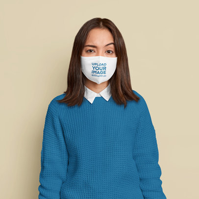 Face Mask Mockup Featuring a Confused Woman Standing in a Studio m3479-r-el2
