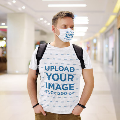 Mockup of a Man Wearing a T-Shirt and a Face Mask at a Shopping Mall 45628-r-el2