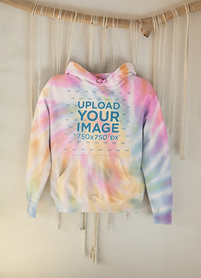 Mockup Featuring a Tie-Dye Hoodie Hanging From a Decorative Branch m4123
