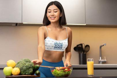 Sports Bra Mockup Featuring a Woman Preparing a Fit Meal m3536-r-el2