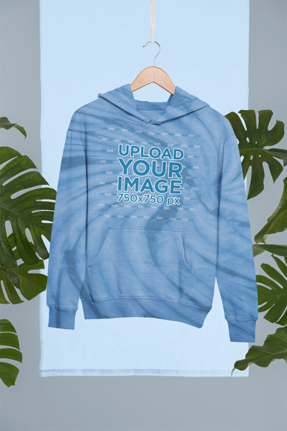 Mockup of a Hoodie with Tie-Dye Texture Placed on a Hanger m4124