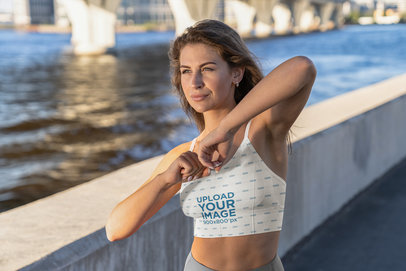 Sublimated Sports Bra Mockup of a Woman Standing by a River m3681-r-el2