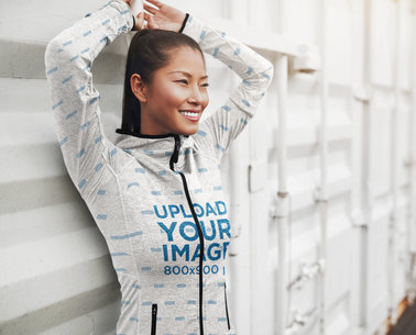 Full-Zip Hoodie Mockup Featuring a Smiling Woman Leaning Against a Wall 41128-r-el2