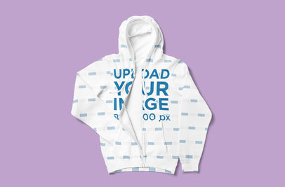 Mockup of a Full-Zip Hoodie Tossed Over a Plain Color Surface 5041-el1