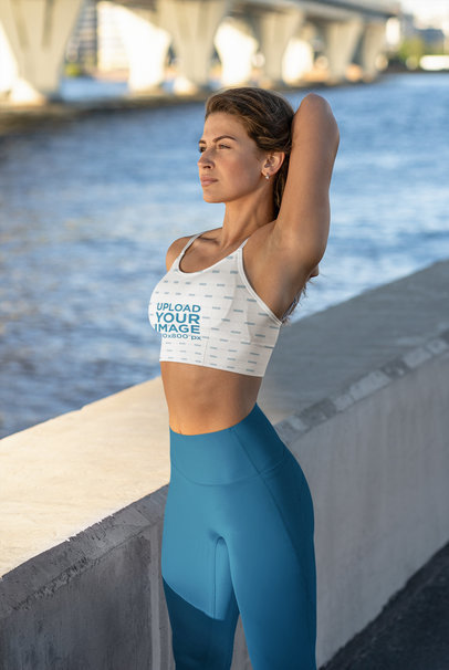 Sports Bra Mockup of a Serious Woman Stretching Her Shoulder by a River m3684-r-el2