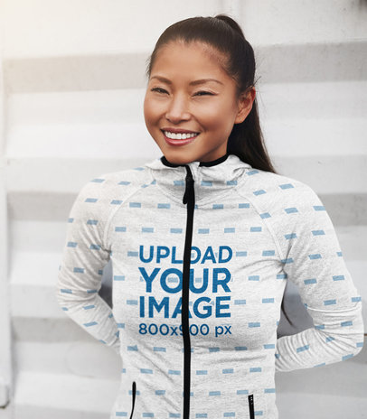 Mockup Featuring a Happy Young Woman Wearing a Sublimated Full-Zip Hoodie 41133-r-el2