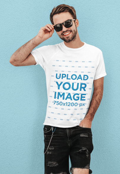 Basic Tee Mockup Featuring a Happy Man With Sunglasses Leaning Against a Colored Wall m1504-r-el2