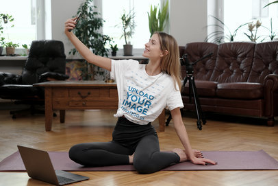 T-Shirt Mockup of a Woman Taking a Selfie After an Indoor Yoga Session m2693-r-el2