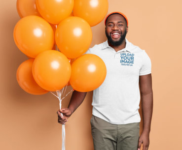 Polo Shirt Mockup of a Man Holding a Bunch of Balloons M3647-r-el2