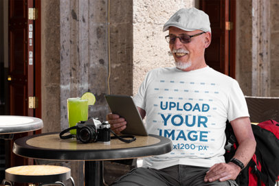 T-Shirt Mockup of a Senior Tourist Having a Drink 32891a