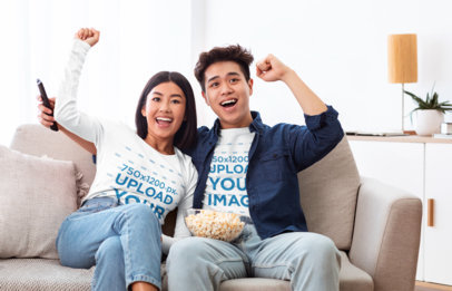 Long Sleeve T-Shirt Mockup of a Young Couple Celebrating While Watching TV 45524-r-el2