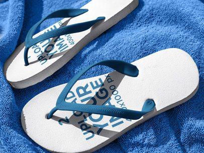 Flip Flops Mockup Lying on a Blue Towel a15439