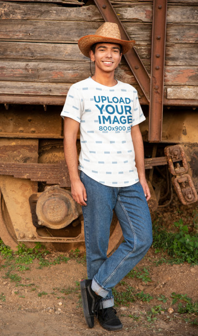 Sublimated T-Shirt Mockup of a Young Man Wearing a Hat in a Rural Scenario 42810-r-el2