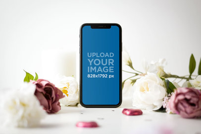 Mockup of an iPhone 11 Surrounded by Valentine's Day Roses 5148-r-el1
