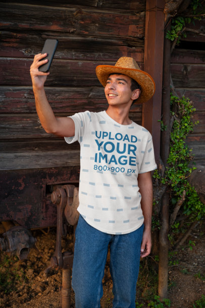 Sublimated T-Shirt Mockup of a Happy Man Taking a Selfie by an Old Train Wagon 42812-r-el2