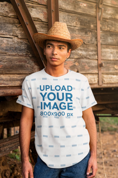 Mockup of a Serious Man With a Sublimated T-Shirt Posing By an Old Train Wagon 42824-r-el2