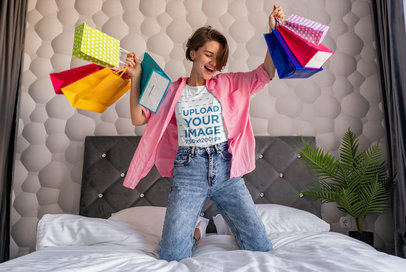 T-Shirt Mockup of a Happy Woman With Shopping Bags m4398-r-el2