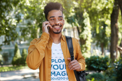 V-Neck Tee Mockup of a Happy College Man Talking on the Phone M4886-r-el2