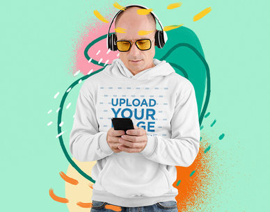 Hoodie Mockup of a Man Listening to Music with an Illustrated Backdrop m5949-r-el2