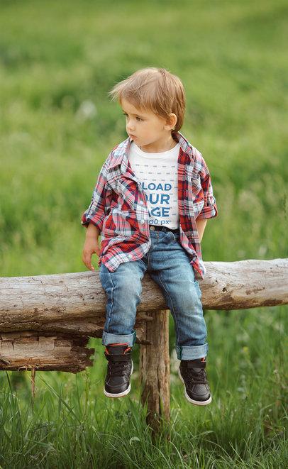 T-Shirt Mockup of a Plaid-Wearing Boy Sitting on a Log m3975-r-el2