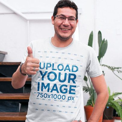 Happy Guy Wearing a Round Neck Tee Mockup While at the Office a15525
