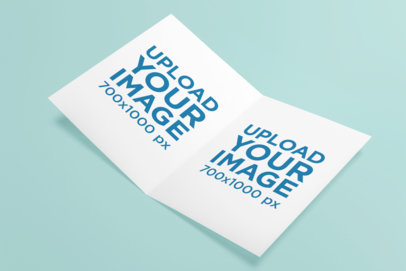 Mockup of a Customizable Greeting Card Placed on a Solid Color Surface 5232-el1