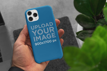Mockup of a Man Holding a Phone Case in His Hand 5165-el1