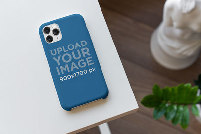 Mockup of a Phone Case Placed on a Home Desk 5176-el1
