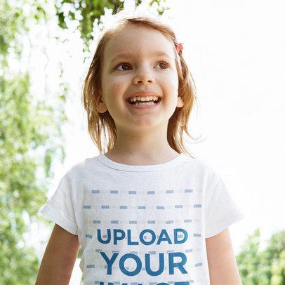 T-Shirt Mockup Featuring a Happy Little Girl m3170-r-el2