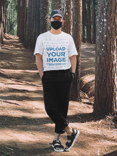 T-Shirt Mockup of a Man Wearing a Trendy Outfit in Nature m3128-r-el2