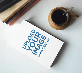 Book Mockup Featuring a Cup of Coffee m3813r-el2