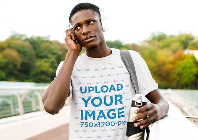 T-Shirt Mockup Featuring a Serious Man Wearing Headphones m4335-r-el2