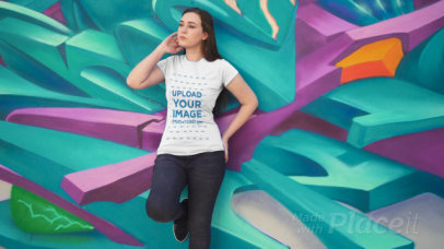 T-Shirt Video of a Woman Posing by an Artsy Wall 3024v