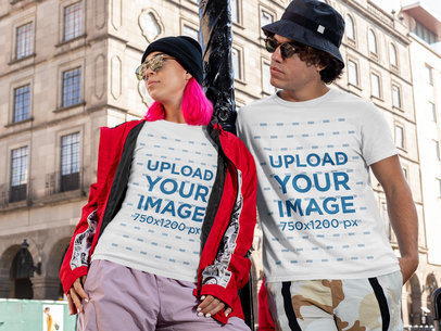 T-Shirt Mockup of a Man and a Woman Posing in a City M513