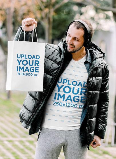V-Neck Tee Mockup of a Smiling Man Holding a Gift Bag M3989-r-el2