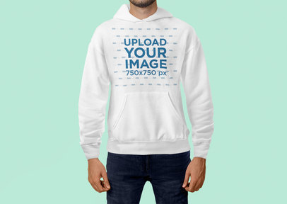 Mockup of a Man Standing at a Studio with a Pullover Hoodie 5094-el1