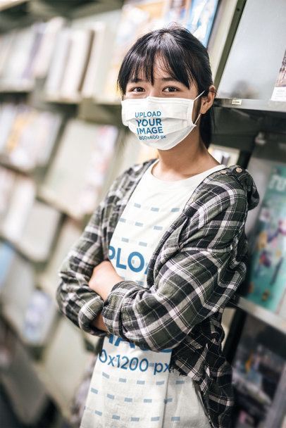 Face Mask and Tee Mockup of a Young Teen in a Bookstore m4653-r-el2