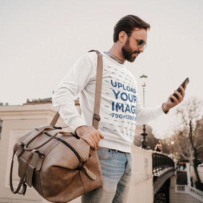 Sweatshirt Mockup of a Bearded Traveler Using His Smartphone m4236-r-el2
