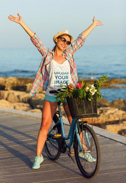 Tank Top Mockup of a Woman Riding a Bike by the Ocean 36130-r-el2