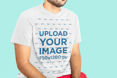 T-Shirt Mockup Featuring a Man with a Beard Sitting in a Studio 44348-r-el2
