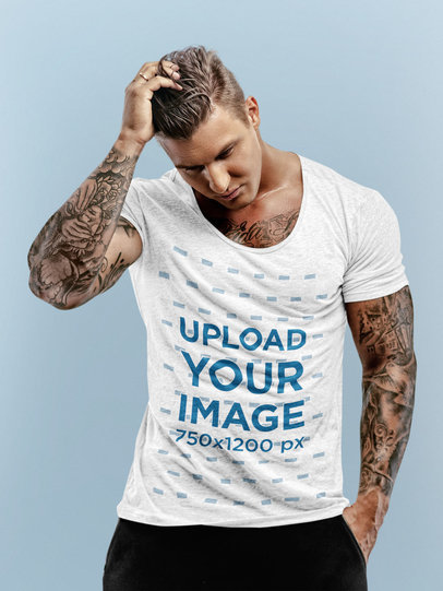 Mockup of a Muscular Tattooed Man Wearing a Heather T-Shirt 44982-r-el2