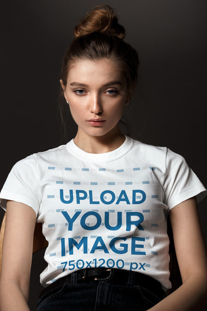 T-Shirt Mockup of a Serious-Looking Woman with a Dark Background 39373-r-el2