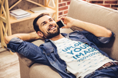 T-Shirt Mockup of a Happy Man Lying on a Couch While Talking on the Phone 45276-r-el2