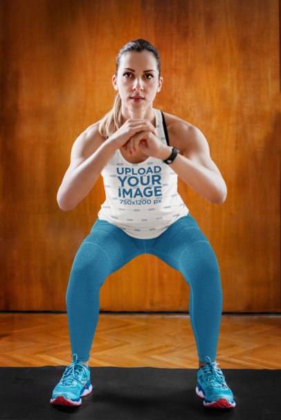 Tank Top Mockup Featuring a Woman Focused Doing Squats 36354-r-el2