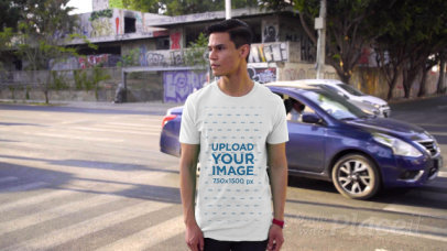Video of a Young Man Wearing a T-Shirt in an Urban Scenario 3108v